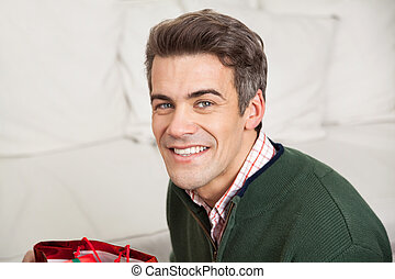 Man Smiling At Home During Christmas