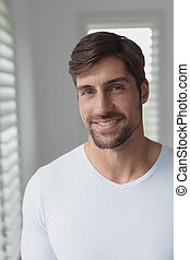Man smiling at home