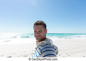 Man smiling at the beach