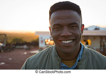 Man smiling on a sunny day