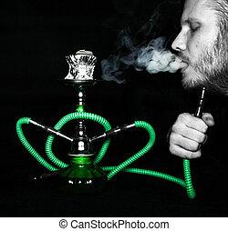 Man smokes a hookah