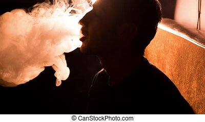 Man smokes hookah one - man smokes a hookah a close-up