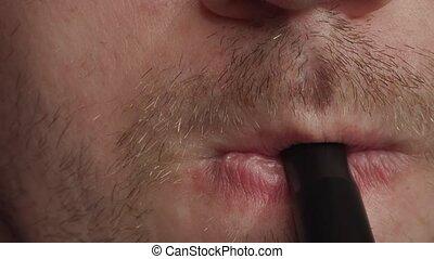 man smoking a hookah close up.