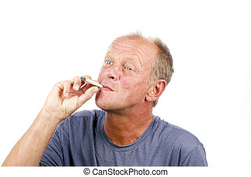 Man smoking a marihuana joint