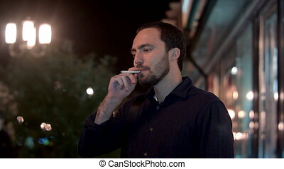 Man smoking at night city. Professional shot on BMCC RAW...