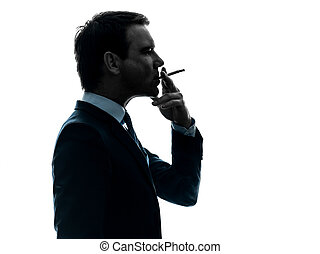 man smoking cigarette silhouette - one caucasian man smoking...