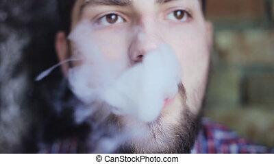 Man smoking electronic cigarette - Man Exhaling smoke from a...