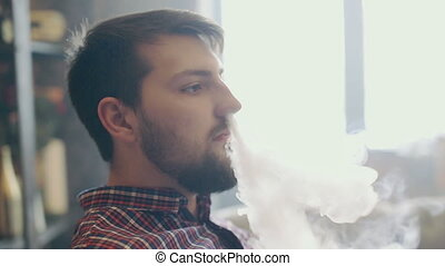 Man smoking electronic cigarette vapor