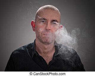 Man smoking with smoke in his face