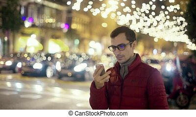 Man Sms Texting Using App on Smart Phone at City