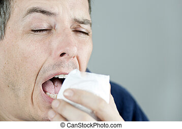 Man Sneezing - Close-up of a man sneezing.