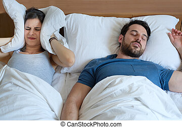 Man snoring in the bed because of night apnoea sleep disorder