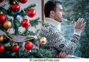Man solitude portrait feeling bad during christmas day