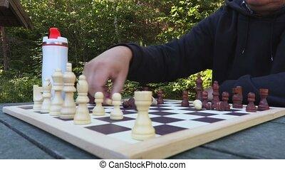 Man sorting chess figures