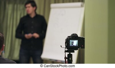 Man speaking on lecture - camera shoot - Man speaking on...