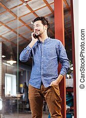 Man speaking on the phone in office
