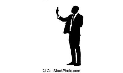 Man speaks by video call on the phone White background. Silhouette