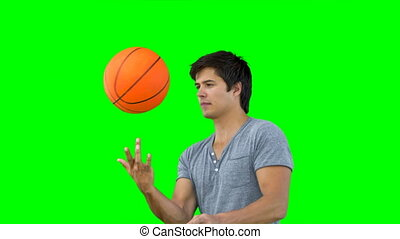 Man spinning a basketball