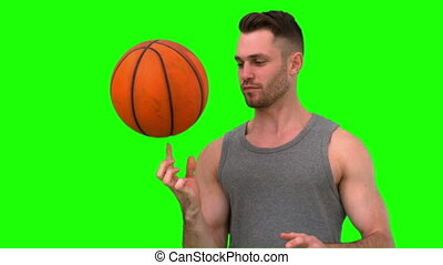 Man spinning the basketball on his