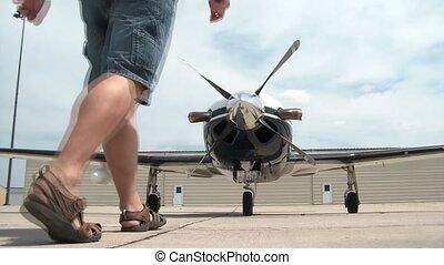Man Spins Propeller on Airplane