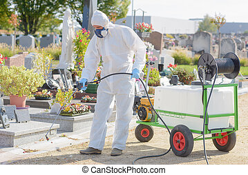 Man spraying chemical weedkiller