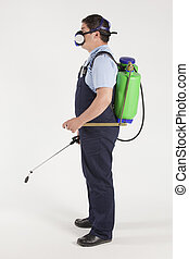 spraying insects - Man spraying insects- pest control