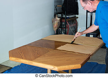 Man Staining A Tabletop - Man Staining And Refinishing A ...