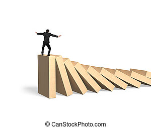 Man standing and balancing on domino