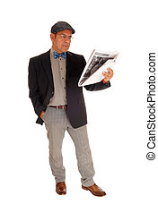 Man standing and reading the newspaper.
