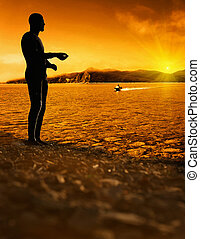 man standing at bright sunset background