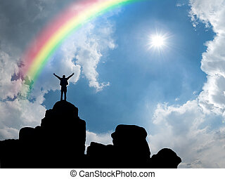 Man standing at mountain top - Happy man standing at ...