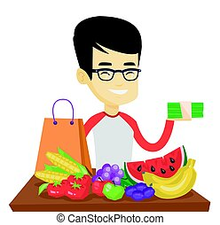 Man standing at the table with shopping bag.