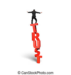 Man standing and balancing on red vertical trust word, isolated on white.
