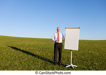 Man Standing By Blank Flipchart, Outdoor