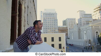 Man standing in balcony at home 4k