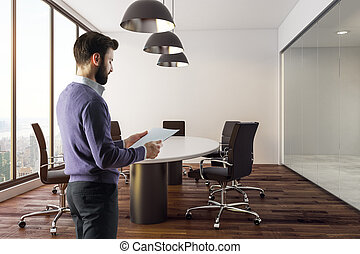 Man standing in conference room