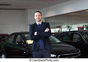Man standing in front of a car