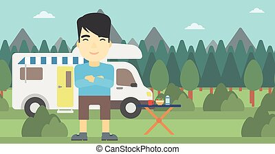 Man standing in front of motor home. - An asian man standing...