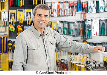 Man Standing In Hardware Store