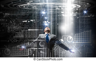 Man standing in light - Businessman with hands spread apart ...