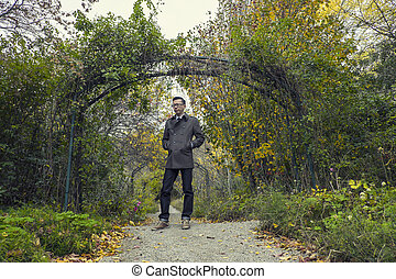 man standing in park Fall Colors