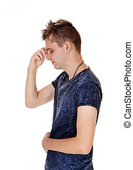 Man standing in profile thinking hard