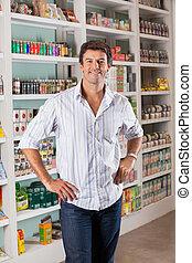 Man Standing In Supermarket