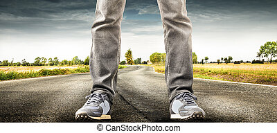 man standing in the middle of the road
