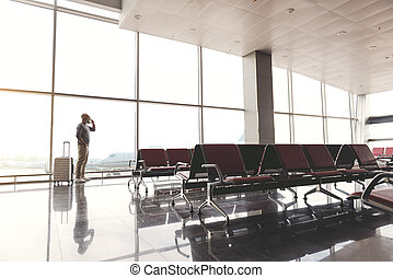 Man standing in waiting hall