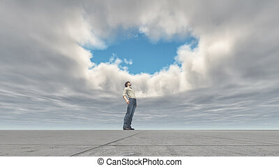 Man standing looking at the sky