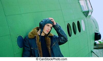Man Standing Near Plane Taking Off Flight Helmet