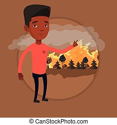 Man standing on background of forest fire.