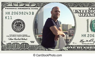 Man standing on balcony in frame 100 dollar bill