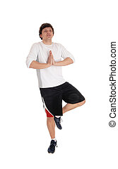 Man standing on one leg doing yoga